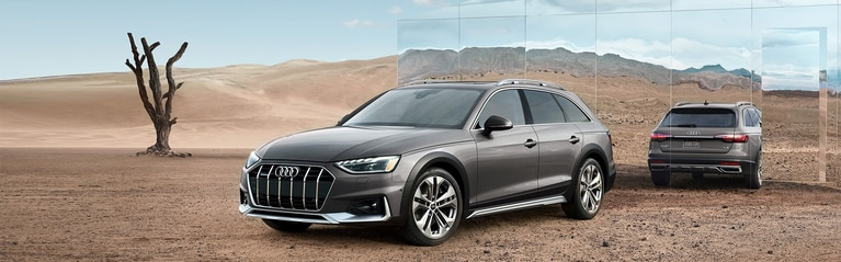 Three-quarter front profile of the Audi A4 allroad® with a scenic background.