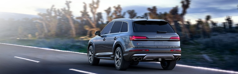 Rear-view of the Audi SQ7 driving on the road.